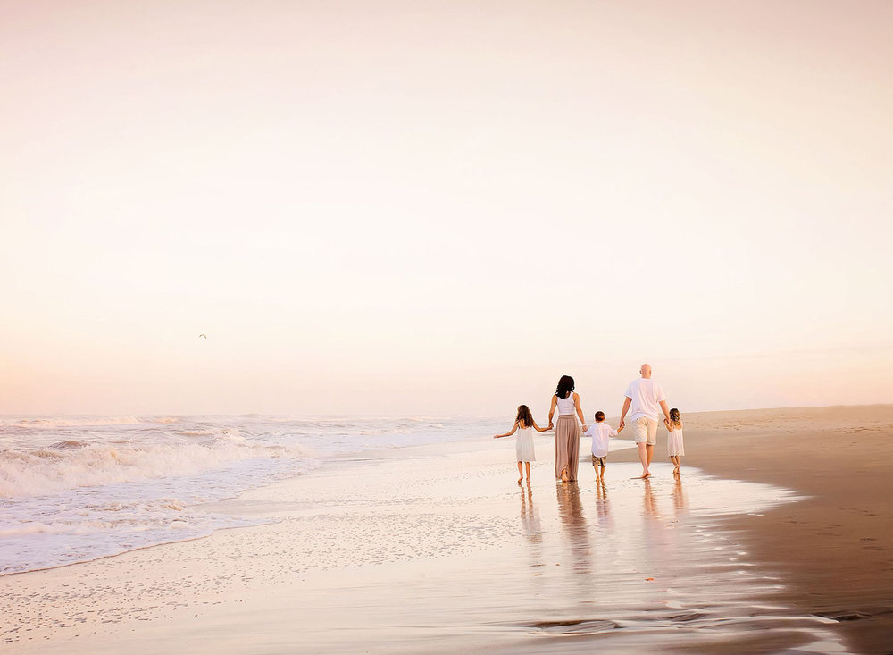 family-walks-the-shore-at-sunset-in-virginia-beach-va-melissa-bliss-photography-lifestyle-photographer-sandbridge.jpg
