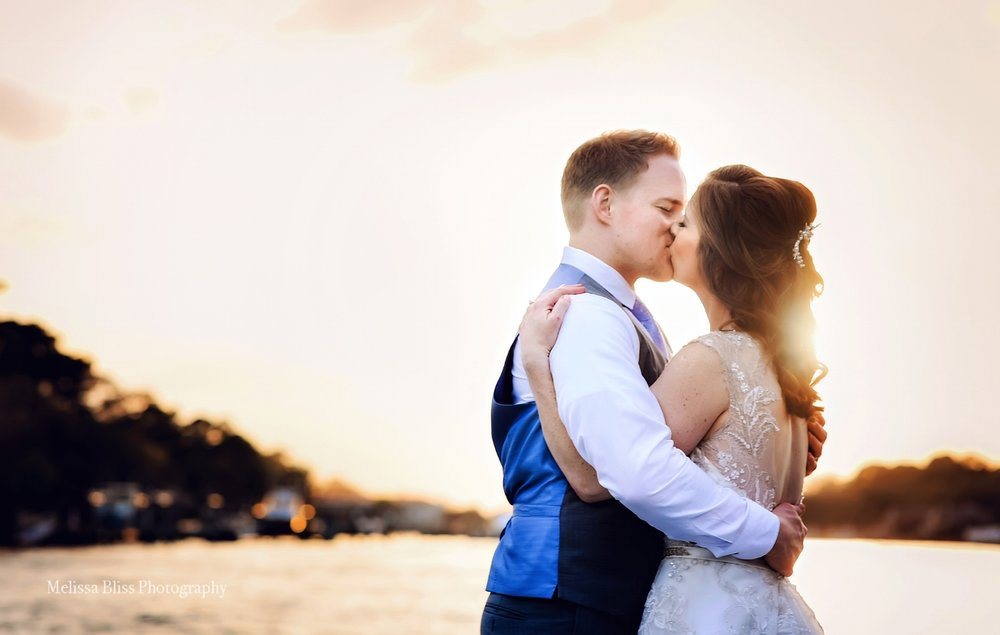 Virginia-Beach-Wedding-photographer-bride-groom-kiss-at-sunset-Melissa-Bliss-Photography-24.jpg