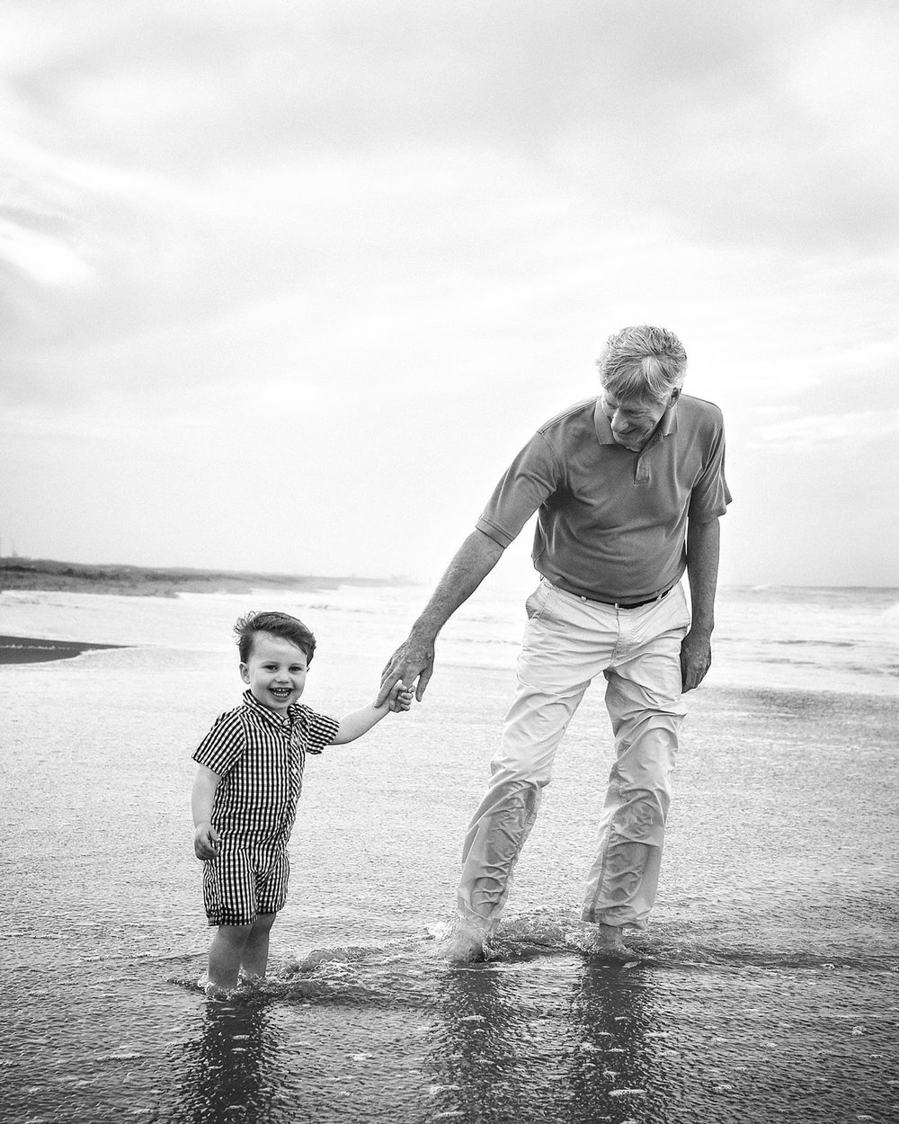 grandfather-grandson-play-on-beach-classic-black-white-melissa-bliss-photography.jpg