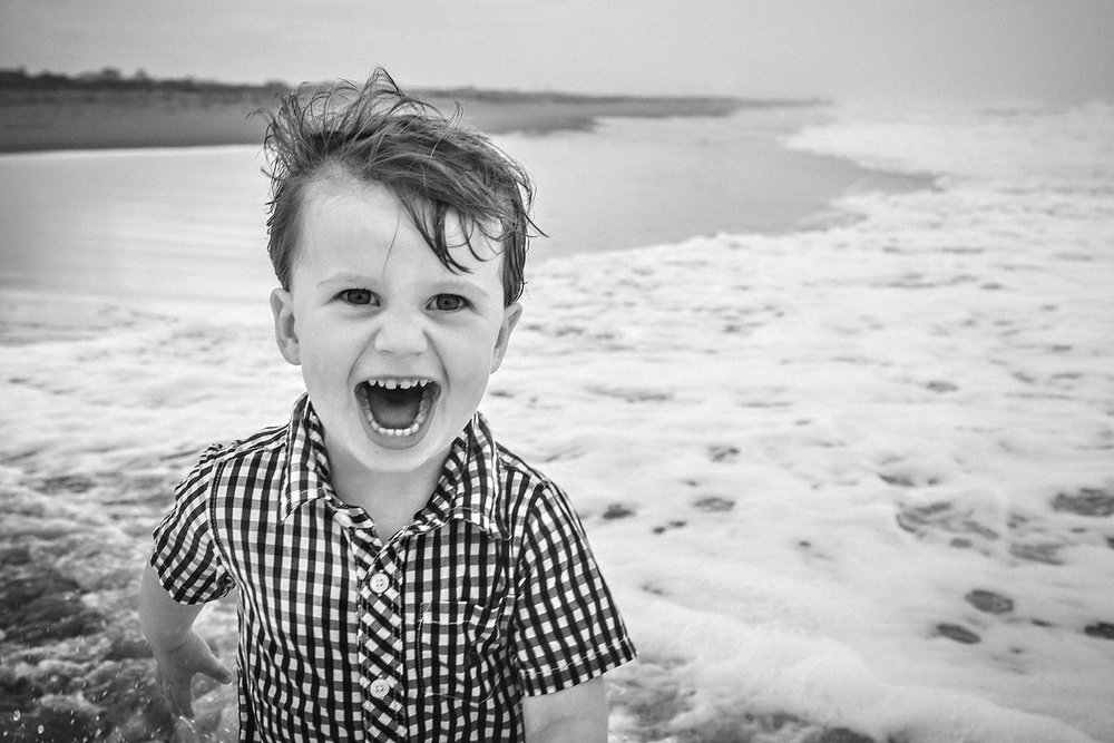 toddler-laughing-in-waves-virginia-beach-melissa-bliss-photography.jpg