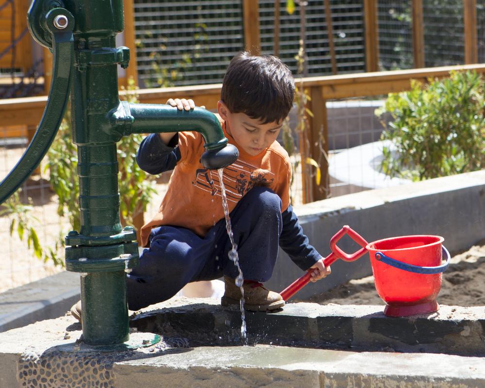 boy with water pump_horiz.jpg