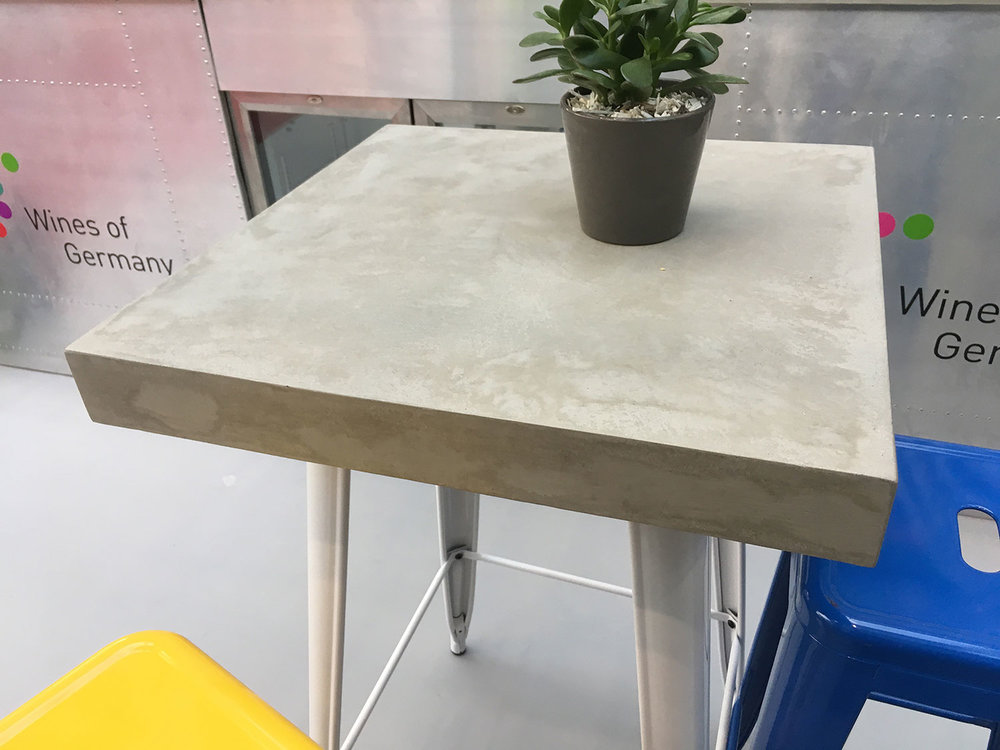 Photo credit: Conscious Forms   Microtop concrete table by Conscious Forms - Partridge Events commissioned this for Wines of Germany. This Microtop concrete is strong enough to use for flooring yet also totally hygienic and suitable for the food and drinks industry.
