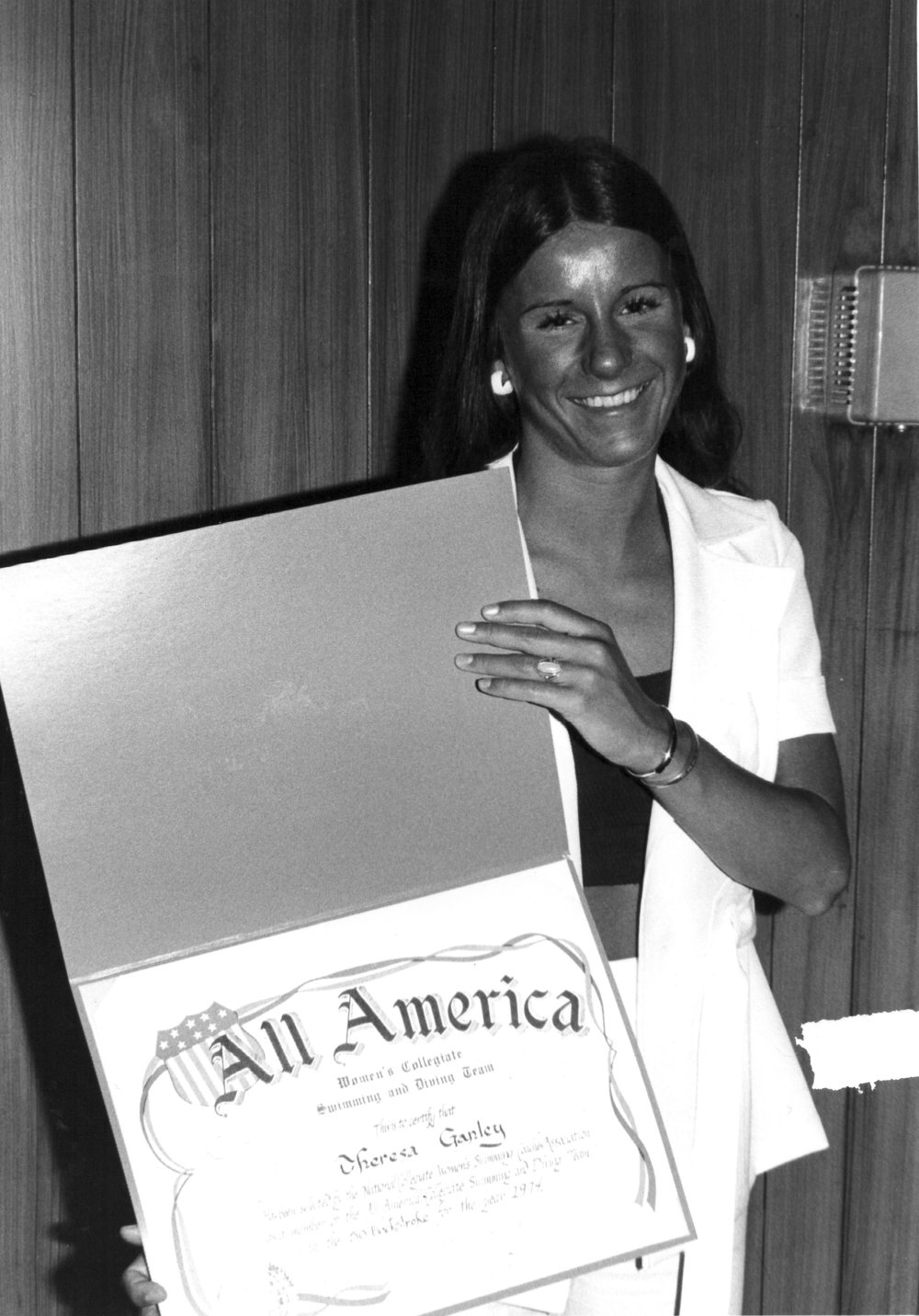 Ganley with her first All-America award in 1974. She was the first female All-American in any sport.