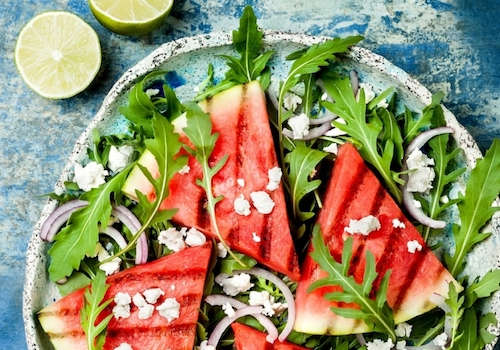 fresh-summer-grilled-watermelon-salad-with-feta-cheese-arugula-onions-picture-id903112390.jpg
