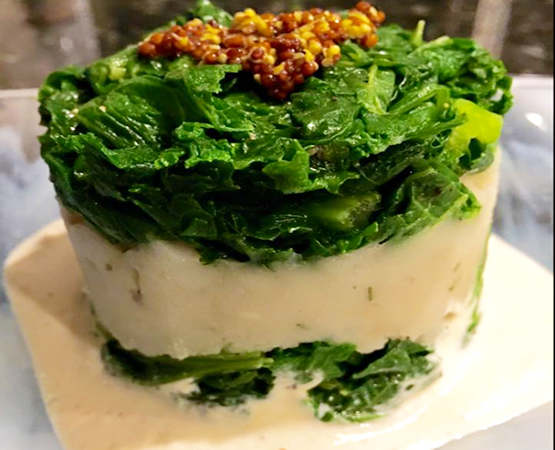 Smoky Mustard Greens Potato Stack w/ Sauerkraut Sauce