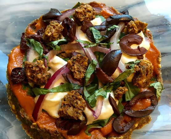 "Raw Vegan Pizza with Buckwheat Crust, Macadamia ""Cheese"" and Fennel Walnut Sausages"
