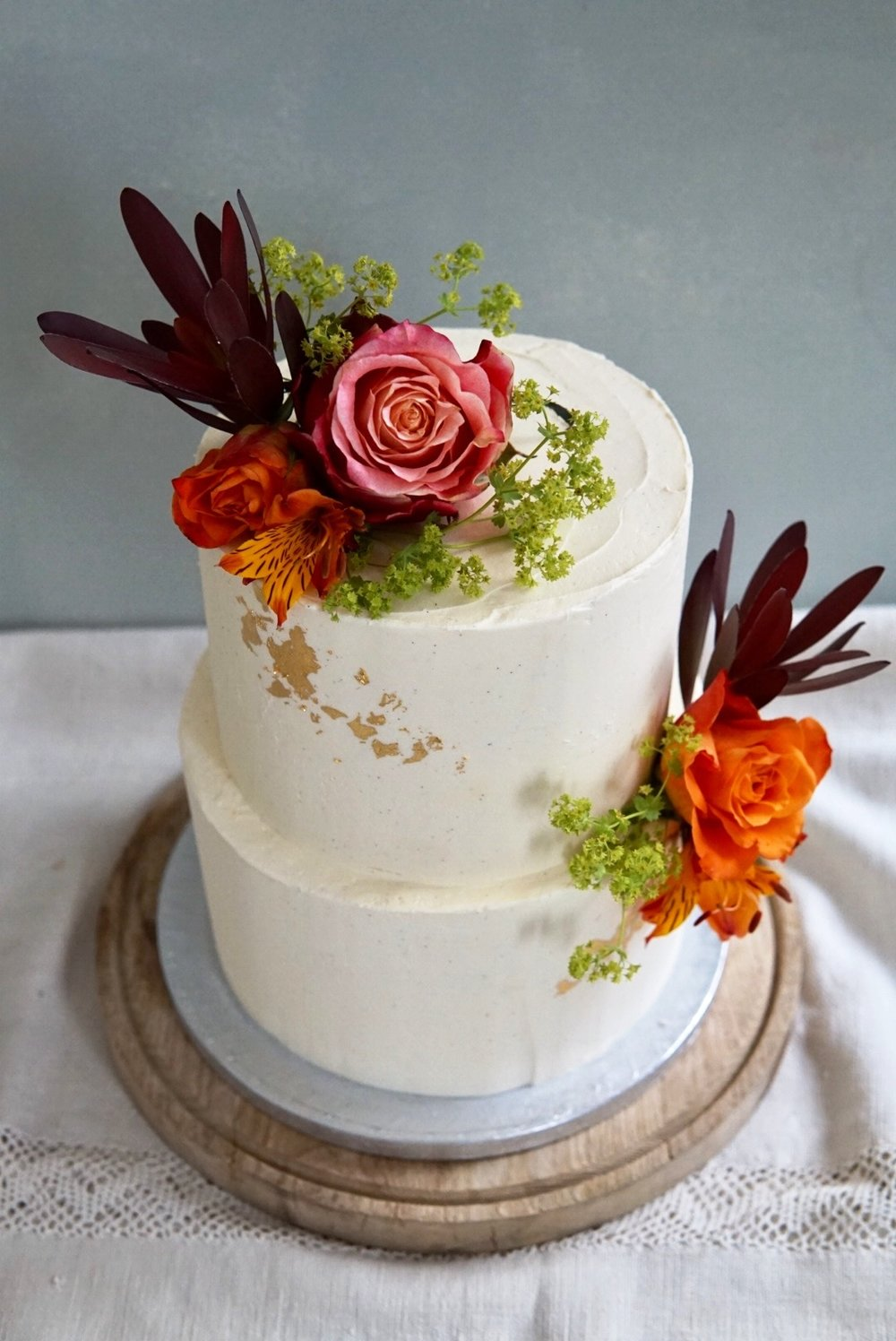 buttercream gold leaf flowers buttercream wedding cake brighton sussex