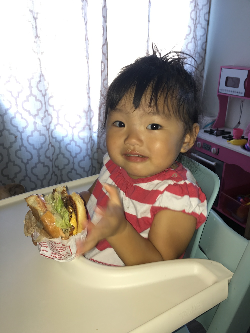 """And me!"" Eating an entire In-n-Out cheeseburger by herself..."