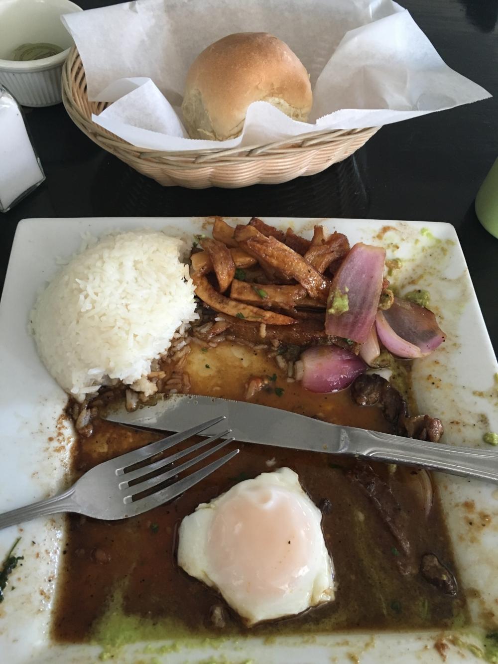 Lomo Saltado menos arroz, papas fritas, y pan.(The egg yolk was saved for last, my fav!)