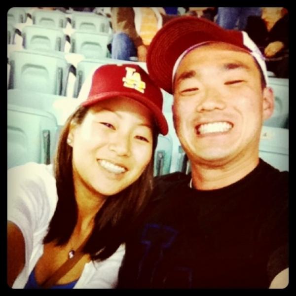 a UCLA fan proudly rocking a USC cap to impress the USC fan.