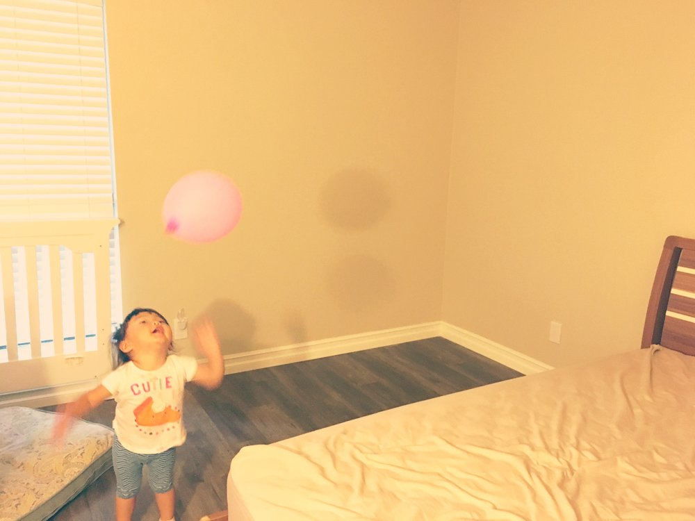 Here, baby #1 celebrating and enjoying all the empty space in the master bedroom!