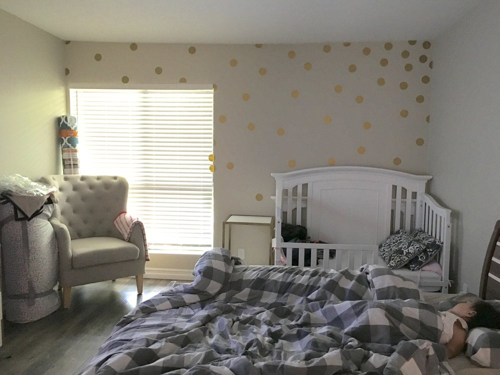 Unfinished but converted the space to accommodate baby #2 (baby #1 enjoying her nap on our bed)!
