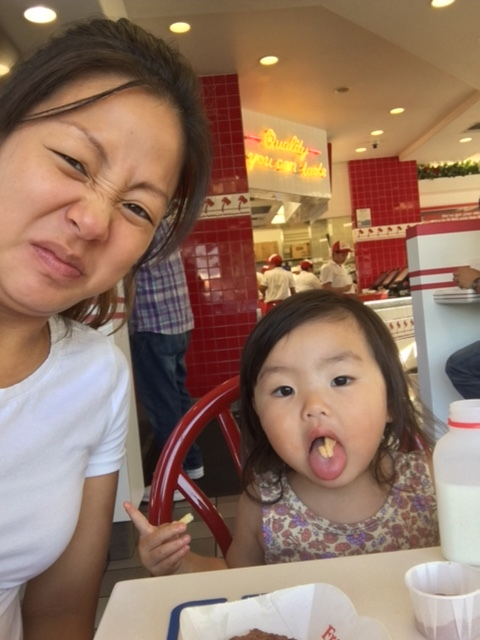 """During one of our Mommy and Halie dates, we went to In-N-Out because she wanted """"french fries"""". Knowing how to pose like this must come from daddy."""