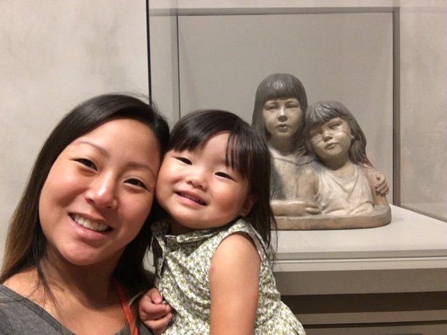 """At the Getty museum, in front of the """"Two Sisters"""" sculpture."""