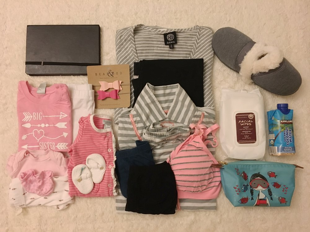 From Left to Right, Top to Bottom: iPad, my going home clothes, slippers, Halie's welcoming clothes, sisters bow hairbands, my pajama set, facial wipes, coconut water, Janie's going home clothes (two sets), 2 sets of big underwear, nursing bra, and toiletries. Not pictured: Kaiser card, phone charger, water tumbler, and birth plan
