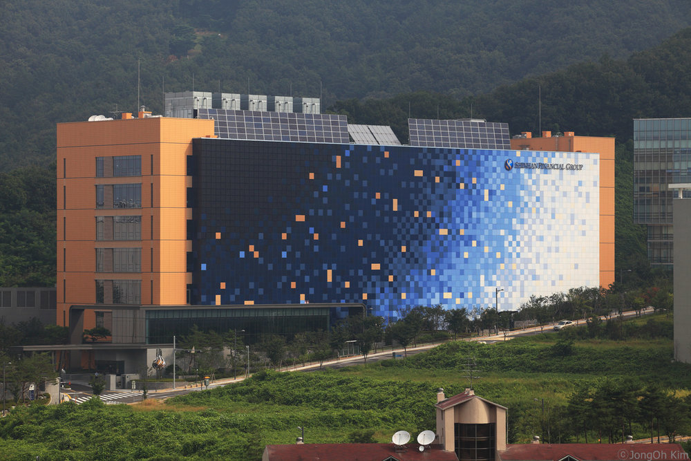 Shinhan Financial Group building in Seoul, South Korea, featuring PV glass from  Energy Glass .