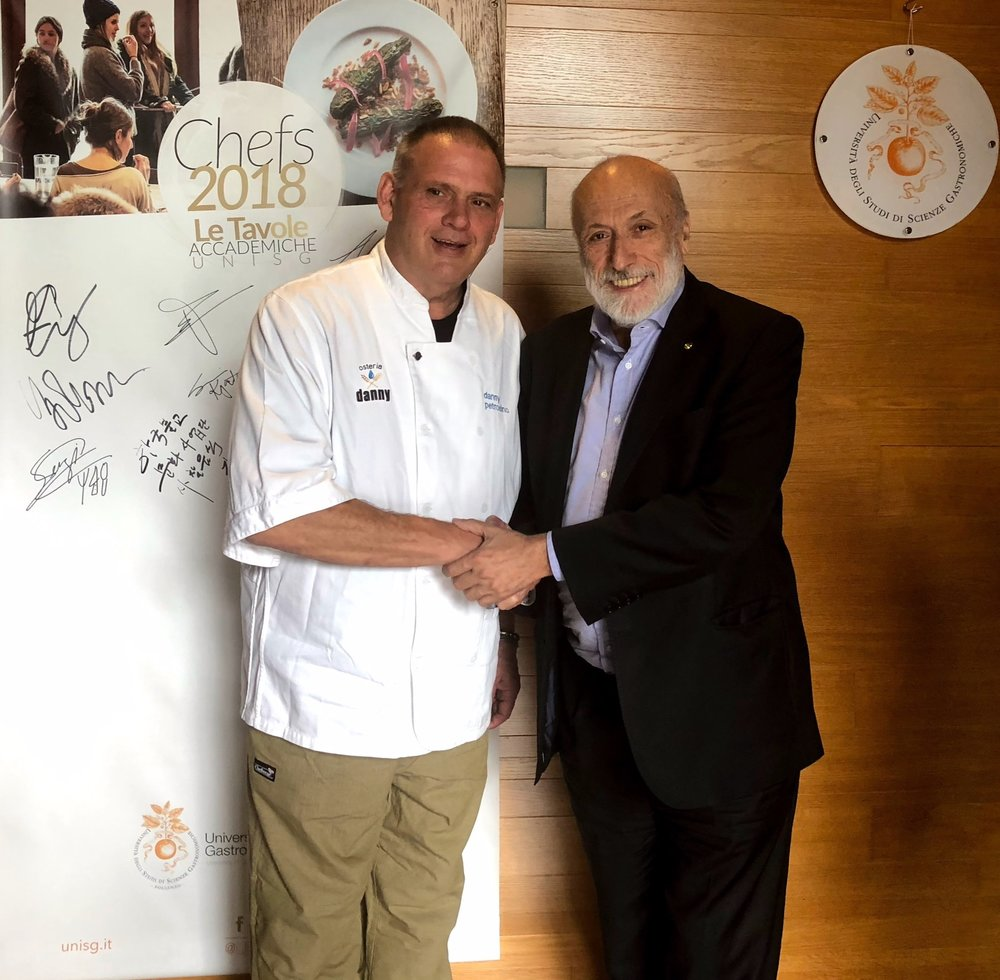 Carlo Petrini welcoming Chef Danny to the University