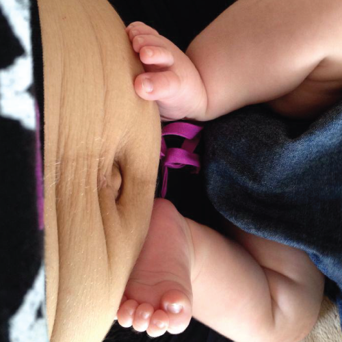 My precious baby's feet, and my incredible tummy that held them....