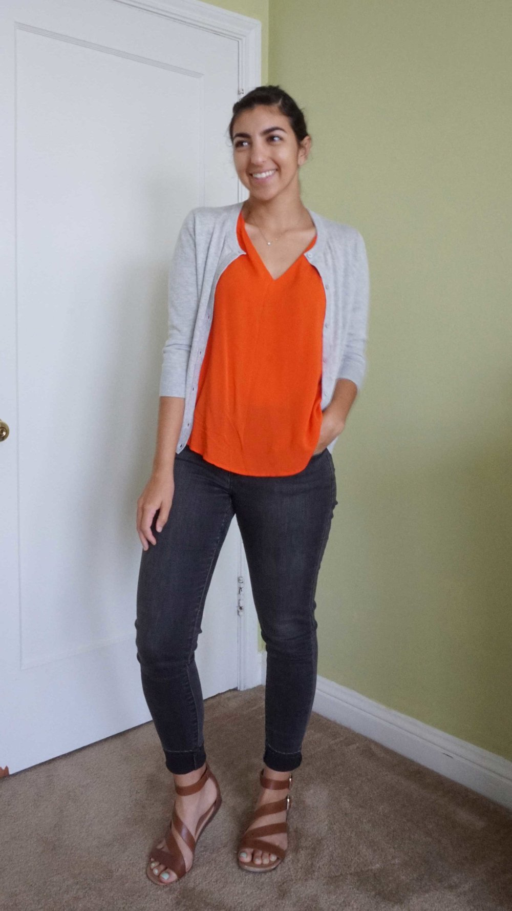 DAY 03 - I was a little uncertain about adding this bright orange top to my summer 10x10, and capsule in general, but ever since I've brought it back into the rotation, I've seen this color everywhere. I love how saturated the orange is and it just gives me energy! I topped the look with  my lightweight gray cardigan to keep me a little warm. Overall, I loved the vibrant and feminine look of this outfit.