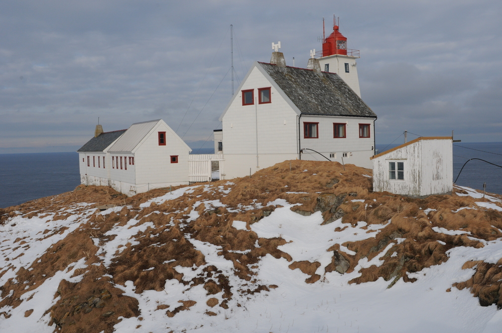 Accommodation on Hornøya is within the Lighthouse Keeper's Cottage, the larger white building with the grey roof. Fantastic views over the Barents Sea stretch out across the horizon.