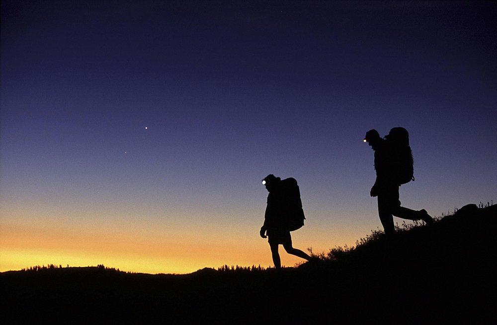 hikers-and-headlamps-at-night-getty-58b987773df78c353cdfa5b8.jpg