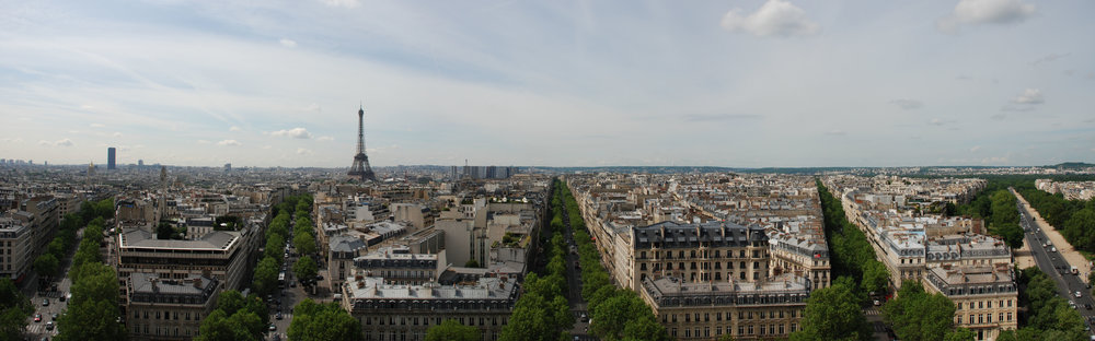 Panorama_of_Paris_from_top_of_Arc_de_Triomphe.jpg