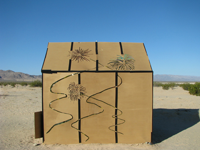 "Installation view in for HDTS in Wonder Valley, Ca. Cardboard, wood, colored gels, tape. 144""x98""x144"""