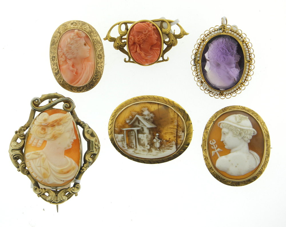 Large cameo on the lower left is likely the oldest. Made in gold fill with a pin that extends past the brooch and does not have a safety. The coral cameo upper middle appears to be from the Art Nouveau period based on the scroll work and symmetry of the mounting.