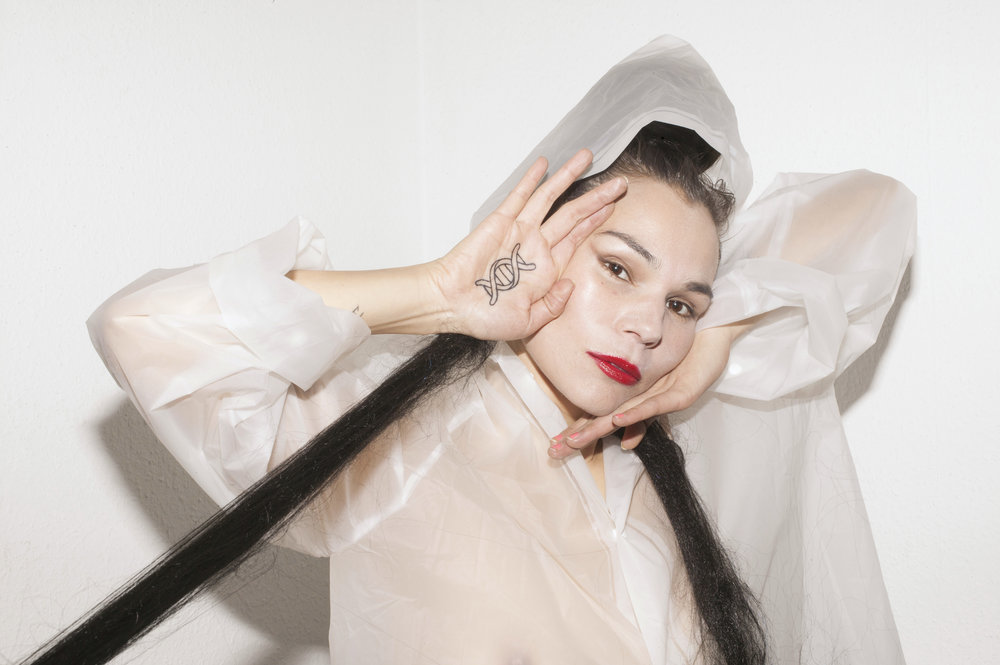 """""""Aïsha's voice is her most powerful tool in a repertoire that includes seraphic and guttural throat singing, mystical linguistics and corporeal sonics"""" - Xlr8r"""