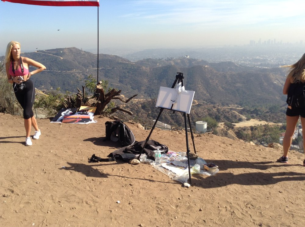 The Live Painting art show of the Hollywood Sign skyline mountain view.