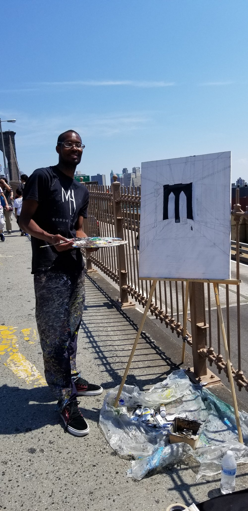 Me painting The Brooklyn Bridge Walkway on the bridge with my display artwork,
