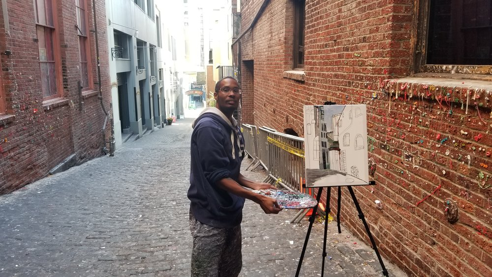 Me working on the live en plein air painting of the Post Alley at the pike place market Gum Wall.