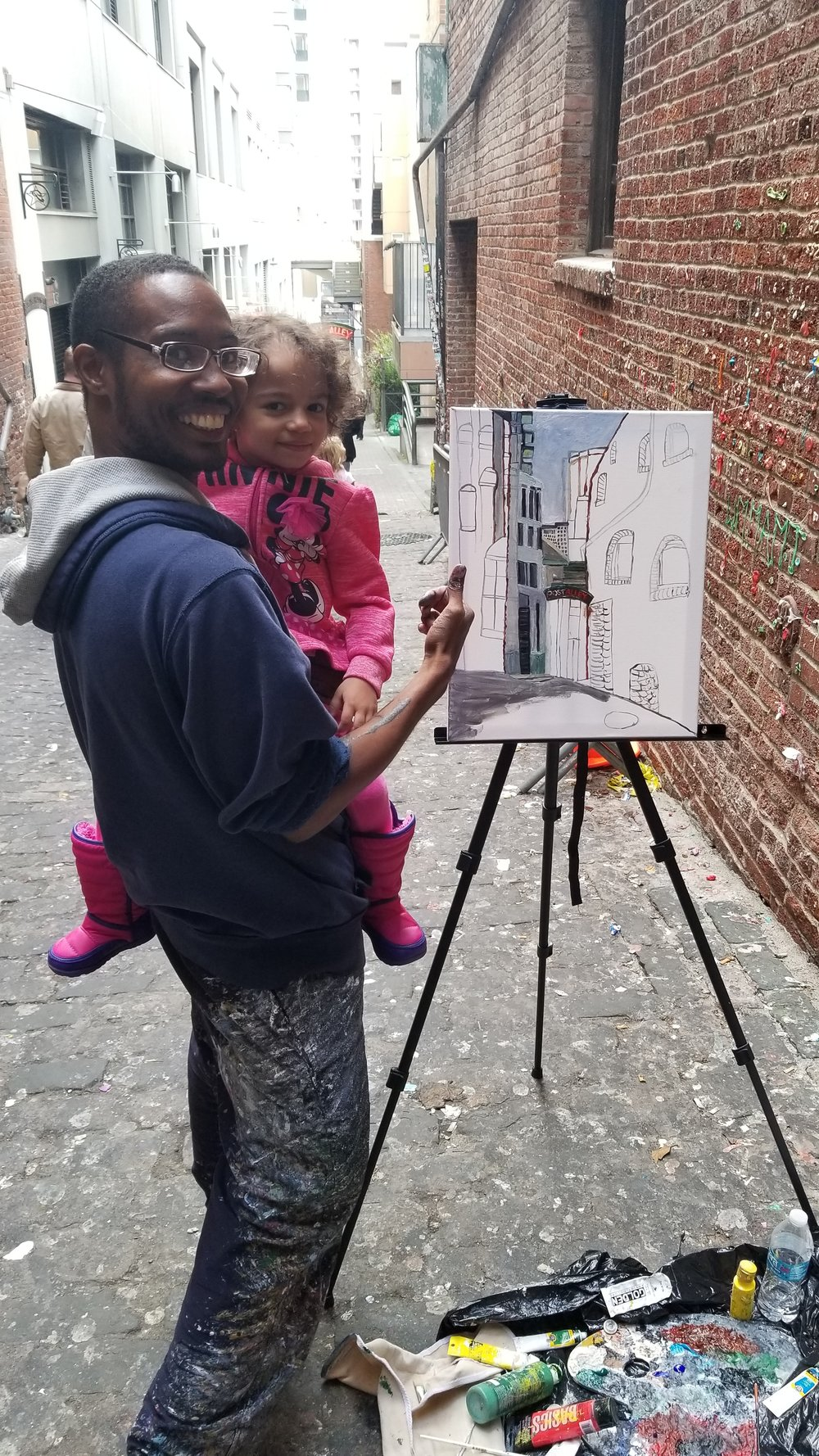 Me and my niece taking a phto together at my live painting show. Finially got to meet her for the first time and my other niece.