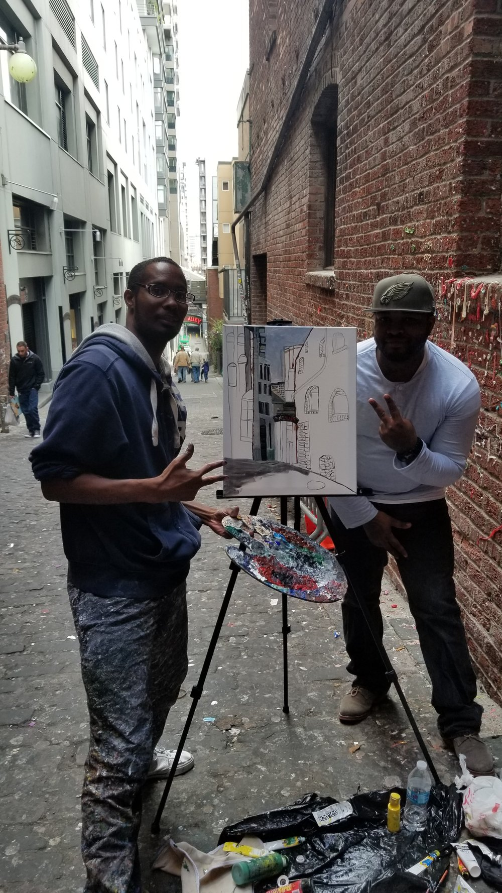Me and my older brother taking a pose with my new artwork.