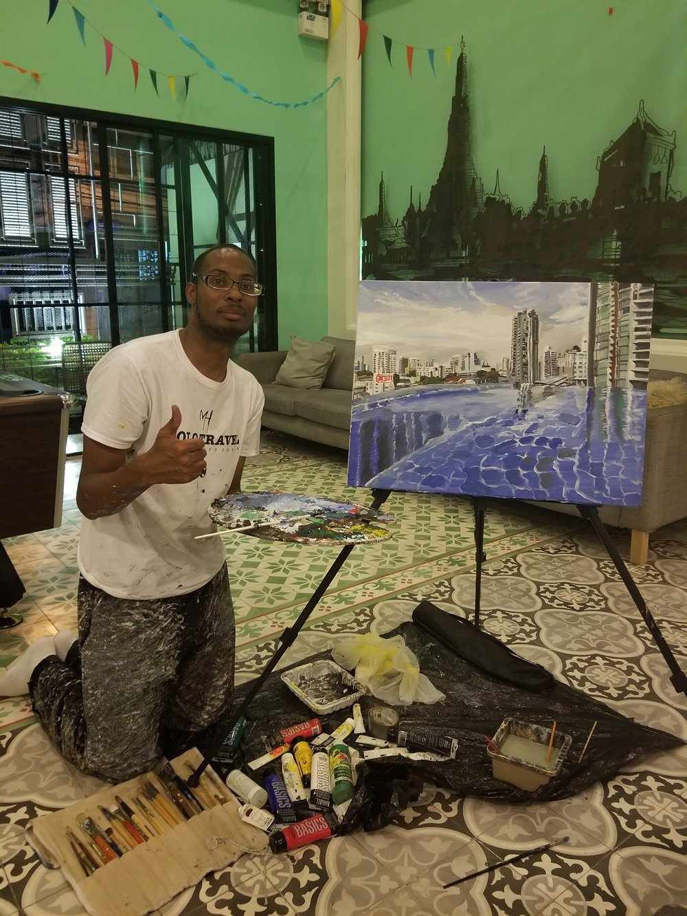 Me finishing up my new product painting at my Hostel that I was staying in Bangkok, Thailand.
