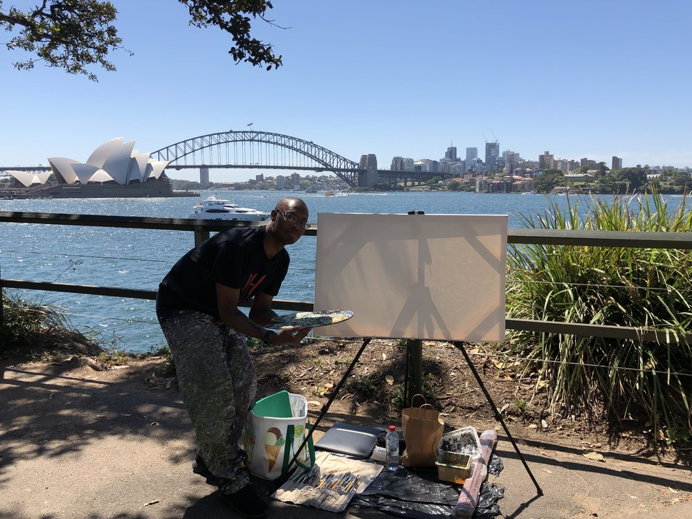 Me setting up my display art project live Painting at the Mrs Macquaries Chair waterview in Sydney, NSW Australia.