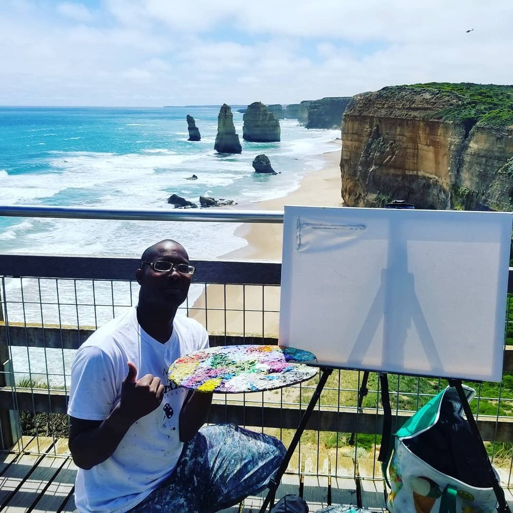 Me setting up my display art project painting at the famous iconic Twelve Apostles National Park in Princetown, VIC Australia.