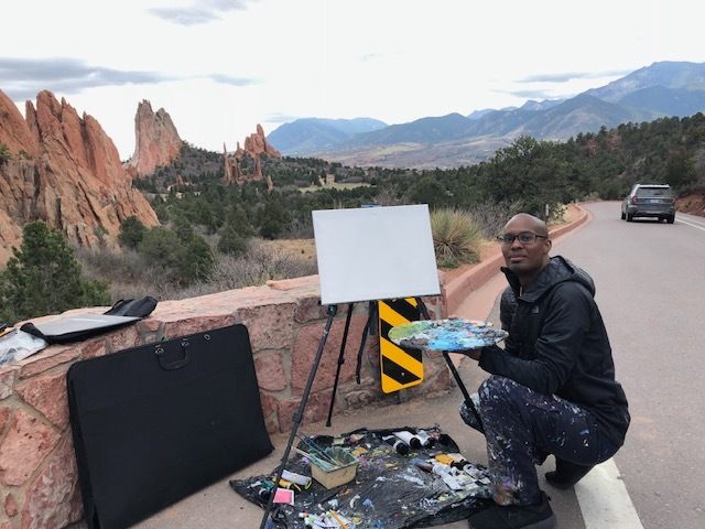 Me setting up my display at the Garden of the Gods Landmark Park.