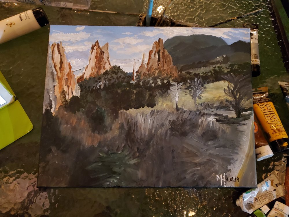 The finished product of the live painting for the Garden of the Gods in Colorado Springs .