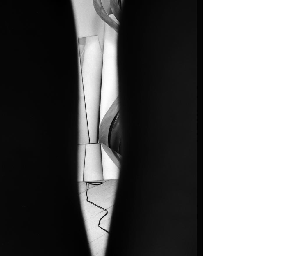 Studio Through Legs 2012, Silver gelatin print, 37 x 29 inches