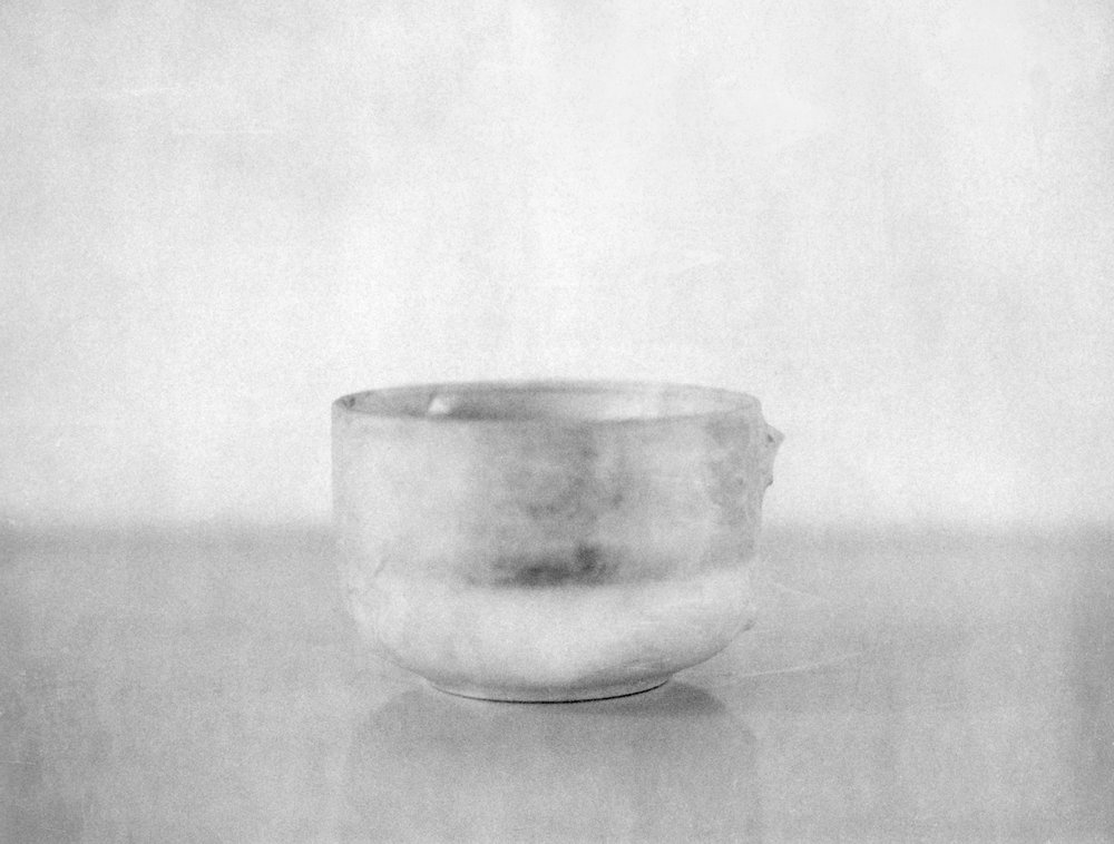 Papered Cup with Broken Handle