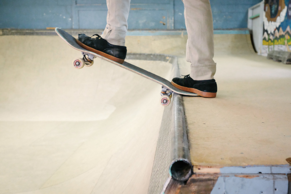 A skater prepares to drop in the bowl at Launch's indoor facility.
