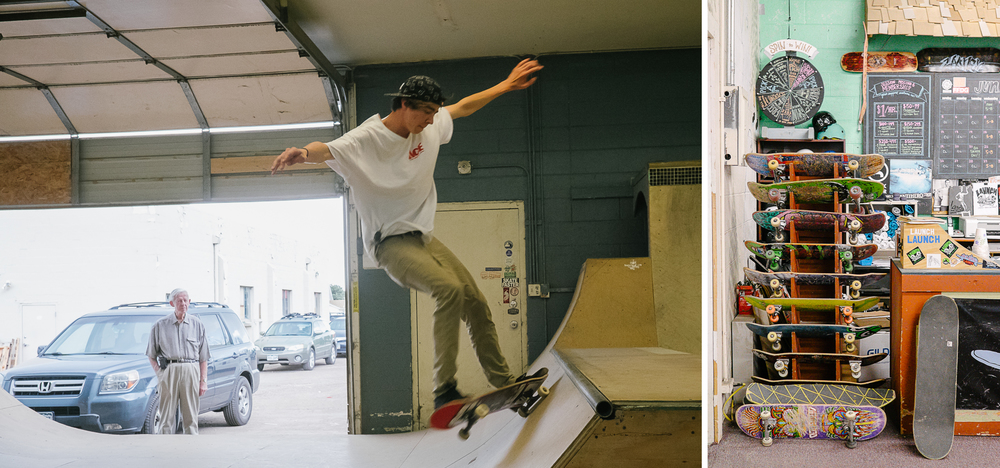 A teen skates at the Launch ramp while a bystander looks on. Skateboards for rent in the Launch office.