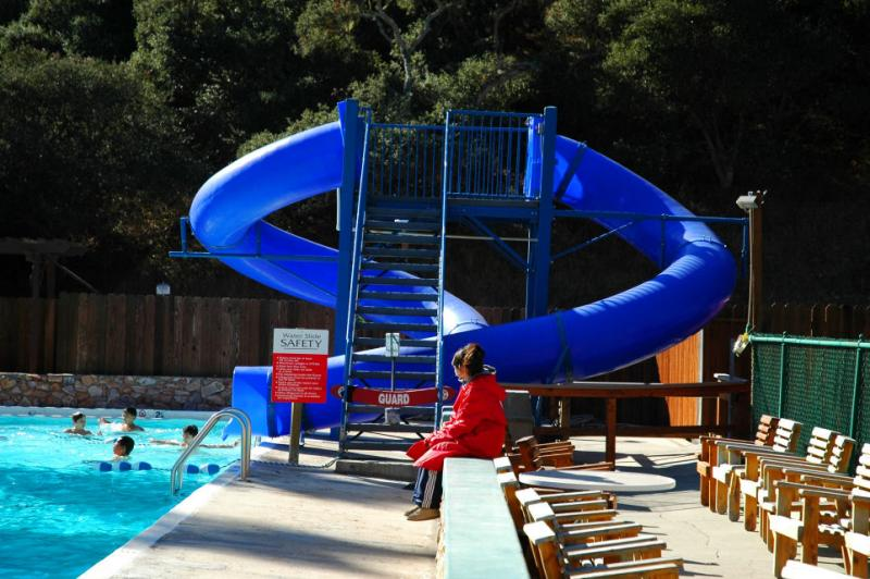 Red Cross Certified Lifeguards monitor the slides