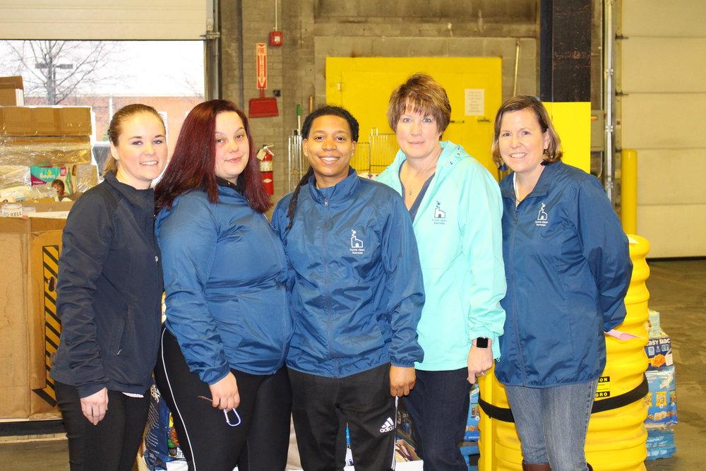 Home Clean Heroes Team Delivering Food Drive Items.jpg