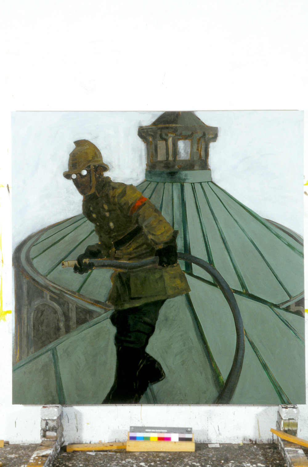 Shostakovitch, dressed as a fireman, on the roof of the Leningrad Conservatoire, 1941