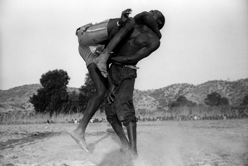 Jack Picone, SUDAN, THE NUBA, Two wrestlers mid match in the Nuba Mountains, Southern Sudan.   Placements:  CHEST & ABS | CHEST, SHOULDER & BACK | CHEST, NECK & BACK | CHEST & ARM | RIB & THIGH |