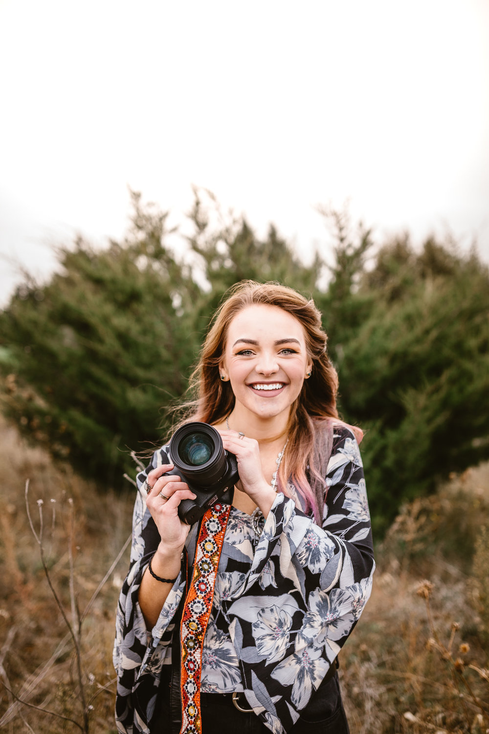 Hi! I'm Hannah Sanderson, & I wanna take your picture! - I love lots of things…music, snowboarding, watching 'The Office', and....taking unique, one of a kind photographs of people that they get to cherish forever!I knew I wanted to be a photographer the day I took photos for a family friend (only because I knew how to use a camera) -- and noticed their reaction towards receiving the pictures. It wasn't just a
