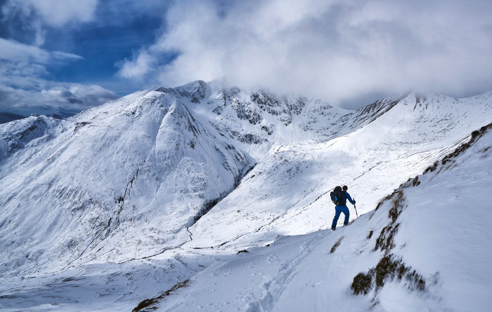 Traversing below the impressive eastern face of Am Bodach.
