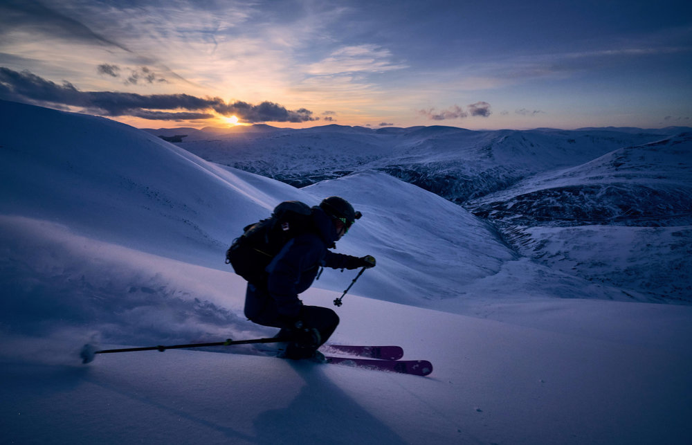 One more lap before sunset? Matt Pavitt skiing off the west side of Creag Leacach as the sun sets over the southern Cairngorms.